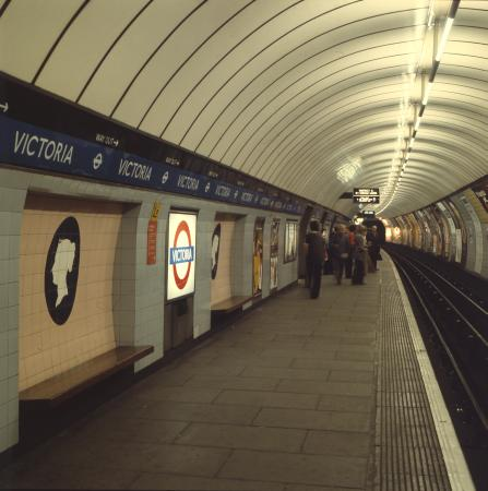 Colour transparency, Platform view of Victoria Underground station, showing illuminated station name roundels, circa 1970