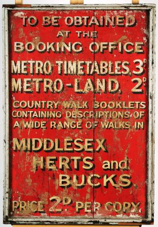 Infromation sign; timber advertising board from aldgate station for metropolitan railway timetables, metro-land and country walks books, circa 1915