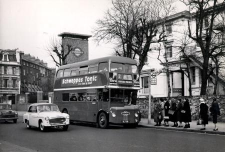 Related object: B/W print; RM-type bus RM1 approaching a bus stop, Colin Tait, 1956.
