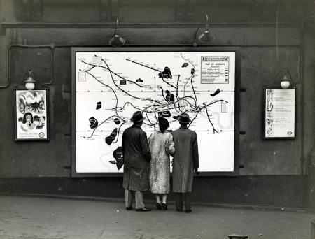 Related object: B/W print; passers-by looking at an enamel map outside Strand Underground station, Topical Press, 1937