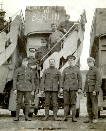 Related object: B/W print; Army Service Corps drivers in front of a B-type bus, by Daily Mirror, 1915