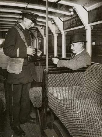 B/w print; passenger buying a ticket from a conductor, by topical press, 1929