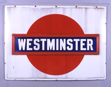 Station name sign; Metropolitan District Railway style solid red disc roundel from the platforms at Westminster station, 1911