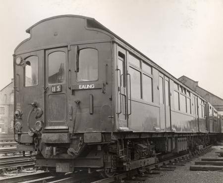 B/w print; three-quarter view of q23-stock train; the car nearest the camera is unit no 4248 by colin tait, 6 dec 1965