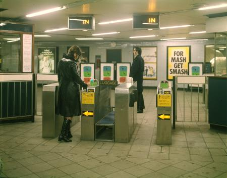 Colour transparency; female passenger passing through an automatic ticket gate, Seven Sisters Underground station, Victoria line, by LT Advertising and Publicity, 1969