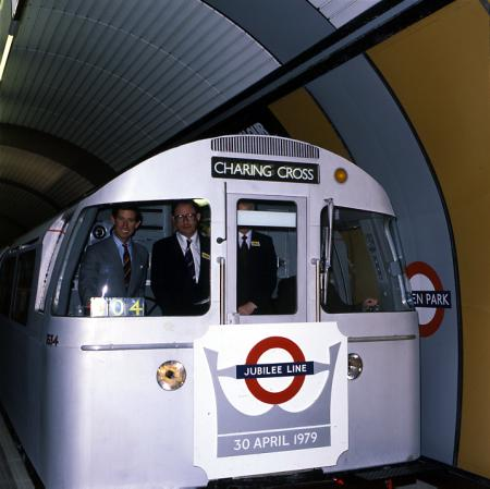 Colour transparency; Prince Charles and William Maxwell in the cab of a Jubilee line train on the official opening, by LT Advertising and Publicity, 1979
