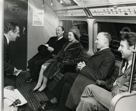 B/w print; queen elizabeth ii inside a victoria line tube stock driving car during the opening of victoria line, bippa, 1969