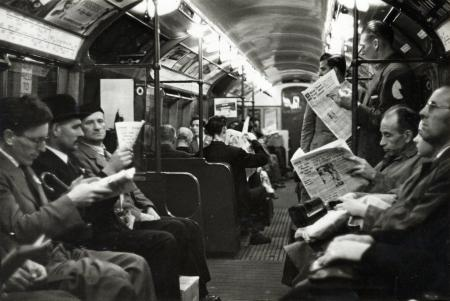 B/w print; interior shot of a 1938 stock tube train on the bakerloo line; most of the seats are occupied by commuters by john somerset murray, jul 1951