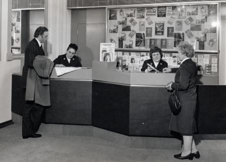 B/w print; customers and staff in the new enquiry office at waterloo main line station by colin tait, 1977