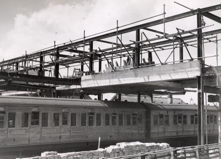 BW print; Work in progress on the construction of the new footbridge at Wembley Park Metropolitan and Jubilee line station by Fox Photos, circa 1947