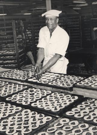 B/w print; a caterer at the croydon food production centre prepares trays of mince pies by sport & general, dec 1970