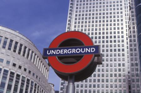 Colour transparency, A three dimensional silhouette Underground roundel displayed at the entrance to Canary Wharf Underground station by Hugh Robertson, 2001